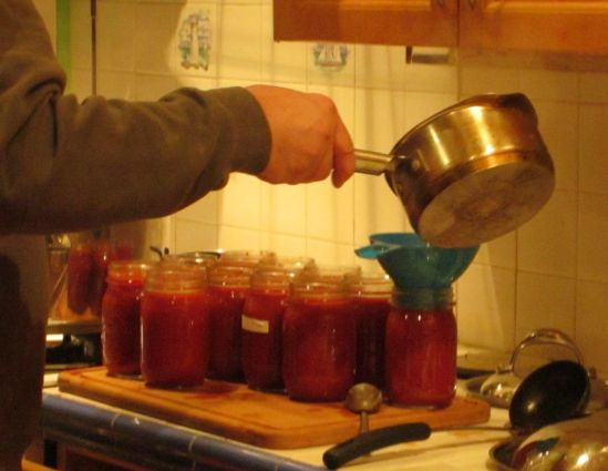 Pete pours the first round of what's probably the last batch of the season's tomato sauce. Next stop on our mad spree: apples.